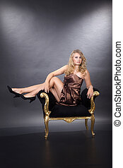 pretty young woman on stool