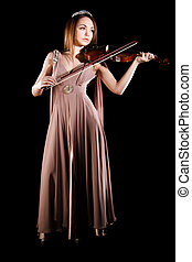 Pretty young woman playing a violin