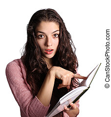 Pretty young woman pointing at the book isolated on white