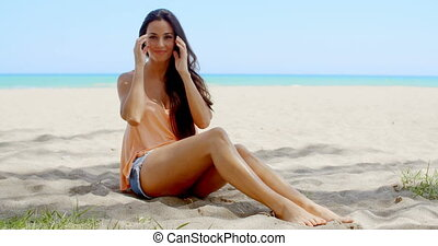 Pretty Young Woman Posing at the Beach Sand