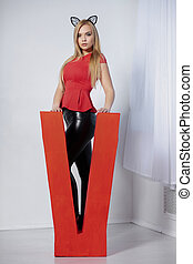 Pretty young woman posing in studio