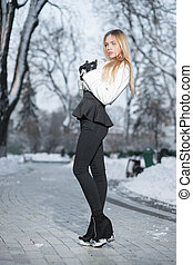 Pretty young woman posing in winter