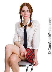 Pretty young woman sitting on a bar chair