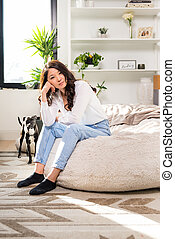 Pretty young woman sitting on a bean bag