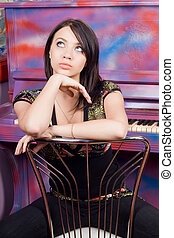 Pretty young woman sitting on a chair