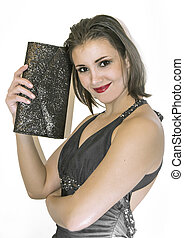 Pretty young woman smiling and holding a handbag