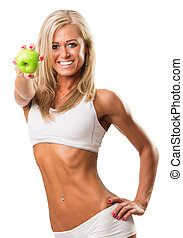 Pretty young woman smiling brilliantly while holding  an apple over white background