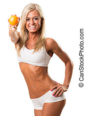 Pretty young woman smiling brilliantly while holding  an orange over white background