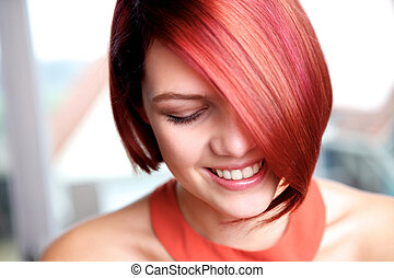 Pretty young woman smiling with eyes closed