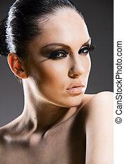 Pretty young woman studio stylish portrait