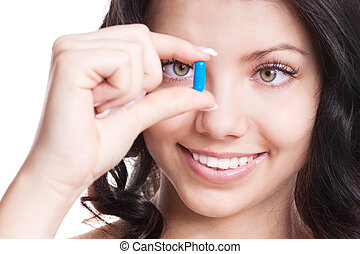 woman taking pills - pretty young woman taking pills,...
