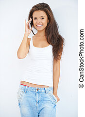 Pretty young woman talking on a mobile phone
