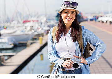 young woman touring at the harbour