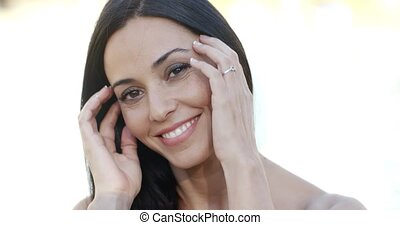 Pretty young woman with a beaming smile