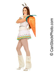 Pretty young woman with a carrot