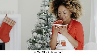 Pretty young woman with a Christmas cake