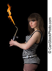 Pretty young woman with a gas torch. Isolated