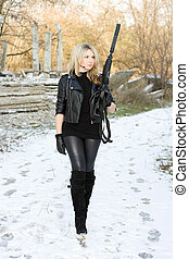 Pretty young woman with a gun