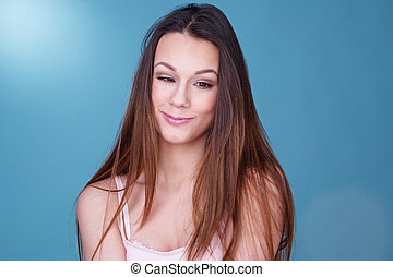Pretty young woman with a whimsical smile