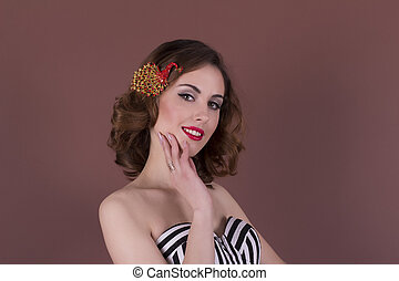Pretty young woman with beautiful barrette on the hair