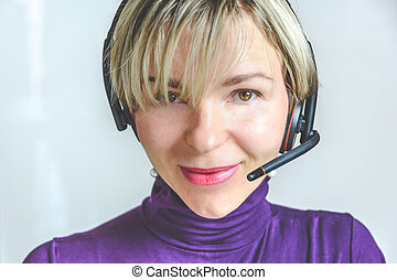 pretty young woman with headset telephone