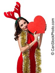 Pretty young woman with heart and reindeer antlers