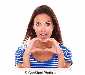 Pretty young woman with heart sign
