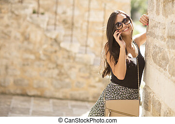 Pretty young woman with mobile phone