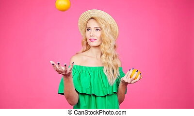 Pretty young woman with oranges - Happy Pretty young woman...
