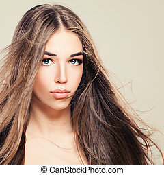 Pretty Young Woman with Perfect Skin and Long Healthy Hair. Beautiful Woman, Skin and Hair Care Concept