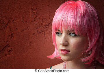 Pretty young woman with pink hair