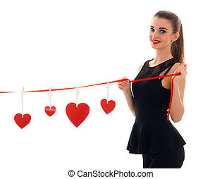 pretty young woman with red lips celebrating valentines day with hearts isolated on white background