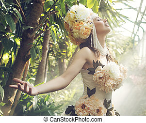 Pretty young woman with the flower hat