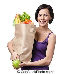 Pretty young woman with the packet full of different healthy nutrition