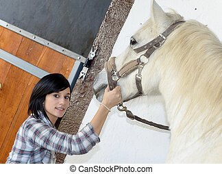 pretty young woman with white horse