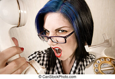 Pretty young woman yelling into a phone