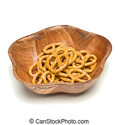 Pretzel Bowl - Heap of Pretzels in wooden bowl isolated...