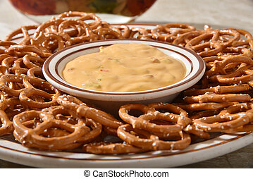 Pretzels and cheese dip - Closeup of a plate of pretzels ...
