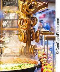 Pretzels and food at German Christmas Market - A rack of ...