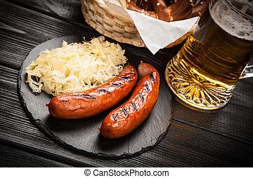 Pretzels, bratwurst and sauerkraut - Traditional german food...