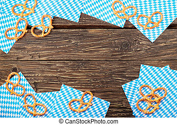 Pretzels on a napkin on wooden table. Bavarian oktoberfest pretzel. Top view with copy space.