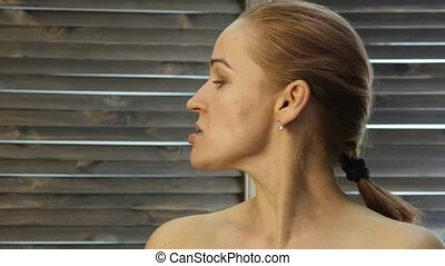 prevention of skin aging, woman performs exercises for a...