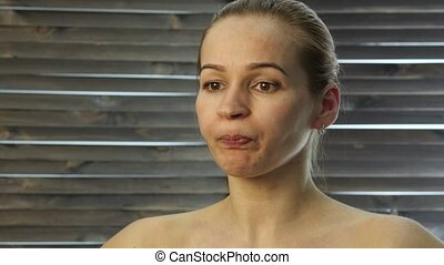 prevention of skin aging, woman performs exercises for a face building. strengthening the muscles around the lips.