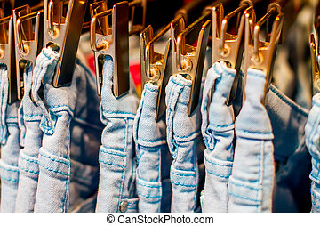 jeans iron clothespins hanging in the closet - Preview jeans...