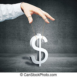 Price manipulation concept - Male hand controlling dollar...