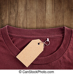 price tag hang over brown tshirt on wood backround