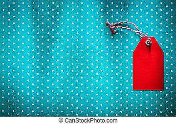 Pricetag on blue polka-dot background copy space