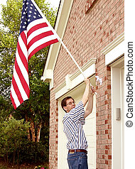 Pride and Patriotism - Raising The American Flag A man...