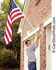 Pride and Patriotism - Raising The American Flag A man...