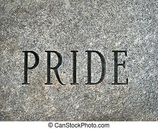 Pride - the word pride carved onto a granite cobble stone